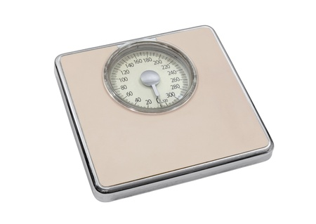 Vintage pink bathroom scale isolated with clipping path.   Stock Photo - 21893555