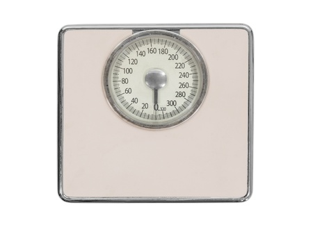 Old pink bathroom scale isolated with clipping path. Stock Photo