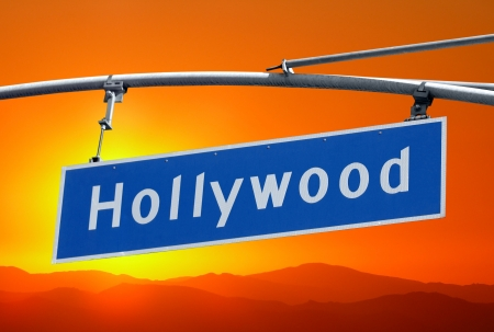 blvd: Hollywood Blvd street sign  and mountains with orange sunset sky. Stock Photo