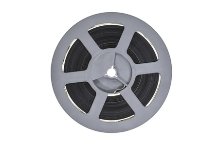super 8: Vintage plastic super 8 film reel isolated on white
