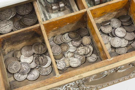 half cent: Vintage cash register money drawer with old US coins.