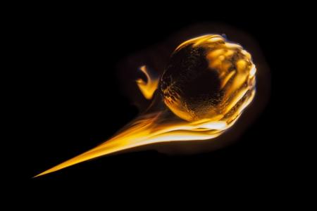 Flaming fireball fastball baseball burning into darkness. Stock Photo - 22023346
