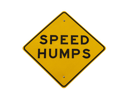 Speed humps road sign isolated with clipping path. Stock Photo - 22819541