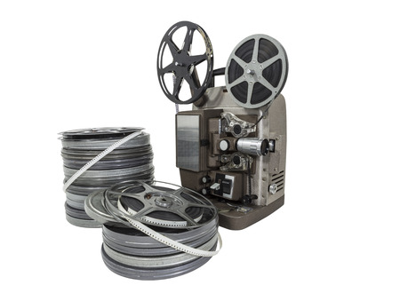 Vintage movie film reels and projector isolated with clipping path. Stock Photo - 23214750