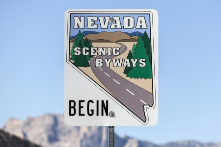Nevada Scenic Byways Highway sign with Red Rock Cliff in background  Stock Photo - 23141260