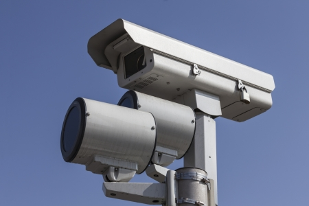 Stop light traffic camera with mounted strobe lights. Stock Photo - 23214771