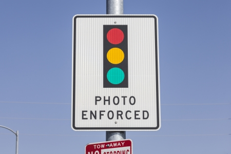 Photo enforced traffic light warning sign. Stock Photo - 23214842