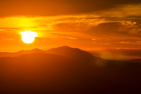 orange county: Setting sun behind the Santa Monica Mountains in Southern California. Stock Photo