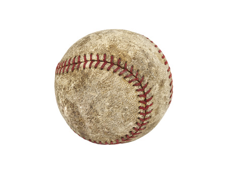 Old worn grungy baseball isolated with clipping path.