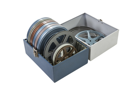 Case of vintage film cans and reels isolated photo