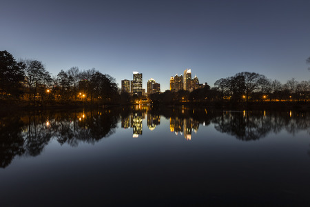 Midtown Atlanta night reflected in the lake at popular Piedmont Park. photo