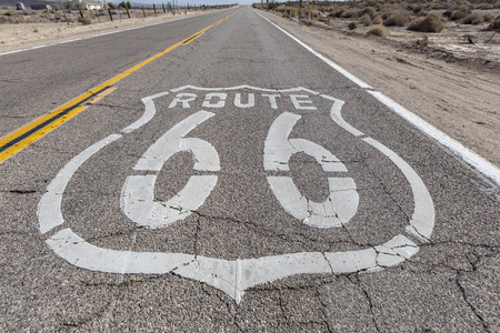 Vintage route 66 highway pavement sign in Californias Mojave desert. photo