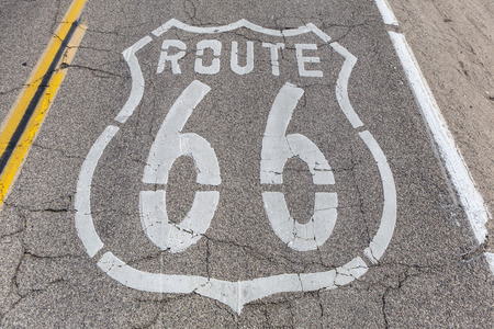 Old US Route 66 pavement sign deep inside Californias mojave desert.   photo