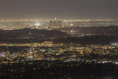 pasadena: Pasadena and downtown Los Angeles at night. Stock Photo