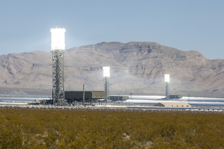 Ivanpah, California, USA - May 14, 2014:  Three glowing white hot towers at the newly operational 392 megawatt Ivanpah solar thermal power plant in California's Mojave desert.