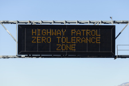 Highway Patrol zero tolerance zone electric warning sign. photo