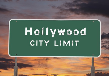 Hollywood city limits sign with sunset sky. photo