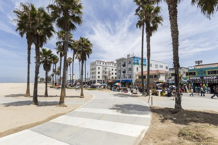 venice: Editorial view of the popular Venice Beach bike path in Los Angeles, California. Editorial