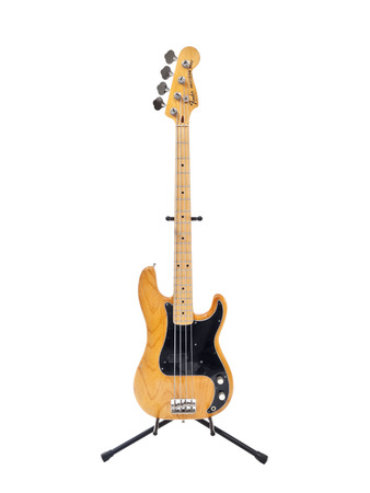 illustrative editorial: Los Angeles, California, USA - August 29th, 2009:  Illustrative editorial photo of a vintage Fender Percission electric bass guitar with an ash body and a maple neck.    Editorial