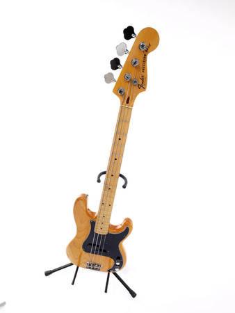illustrative editorial: Illustrative editorial photo of a vintage Fender Precision Bass Guitar.