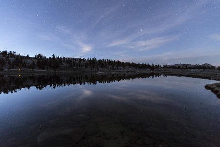 high sierra: Star reflections in Cirque Lake high in Californias Southern Sierra Wilderness. Stock Photo