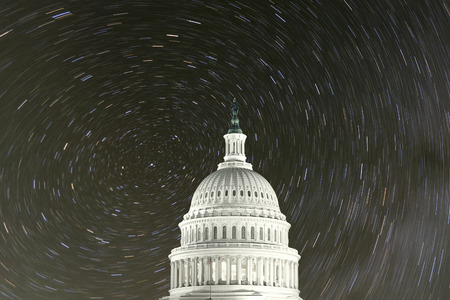 United States Capitol Building with north star rotation night sky.