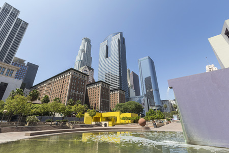 pershing: LOS ANGELES, CALIFORNIA - June 29, 2014:  Editorial view of Pershing Square Park and the downtown Los Angeles skyline.
