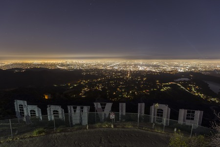 hollywood hills: Los Angeles, California, USA - July 2, 2014:  Editorial view of the city of Los Angeles from hilltop behind the iconic Hollywood sign.