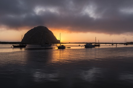 After sunset view of small boats resting in scenic Morro Bay, California