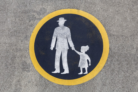 Weathered pedestrian sidewalk pavement sign. Stock Photo