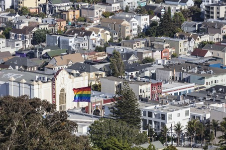 gay pride flag: San Francisco, California, USA - July 5, 2014:  Hilltop view of San Franciscos culturally diverse Castro District neighborhood.