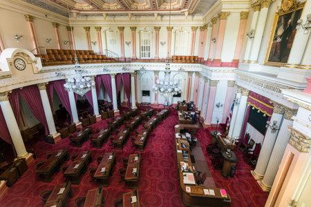 Sacramento, California, USA - July 4, 2014:  Interior of the California State Senate meeting room in the state capitol building in Sacramento, California.