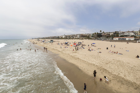 MANHATTAN BEACH, CALIFORNIA - July 15, 2014:  Summer beach goers and affluent homes in the town of Manhattan Beach in Los Angeles County.   Editorial