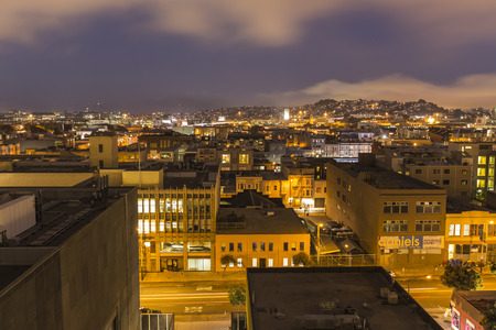 SAN FRANCISCO, CALIFORNIA - July 5, 2014:  San Franciscos urban South of Market neighborhood at night.