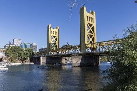 SACRAMENTO, CALIFORNIA - July 4, 2014:  Holiday boat users gather near the historic Tower Bridge in Sacramento, California. Editorial