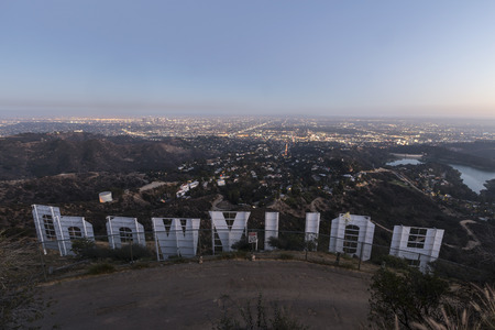 los: LOS ANGELES, CALIFORNIA - July 2, 2014:  Back of the Hollywood sign above the city of Los Angeles at dusk.   Editorial