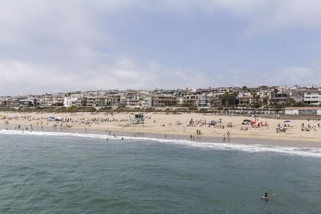 MANHATTAN BEACH, CALIFORNIA - July 15, 2014:  Summer beach goers crowd the sand at Manhattan Beach in Southern California.