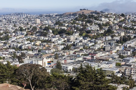 gay pride flag: SAN FRANCISCO, CALIFORNIA - July 5, 2014:  Hilltop view of San Franciscos socially diverse Castro district.