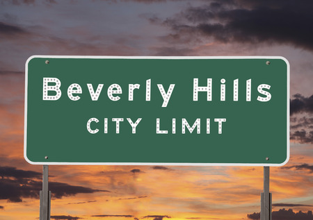 Beverly Hills city limits sign with sunset sky.