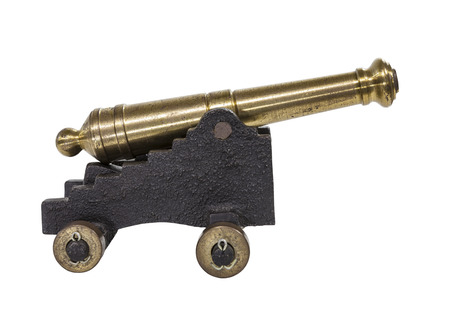 Old toy cannon isolated on white.