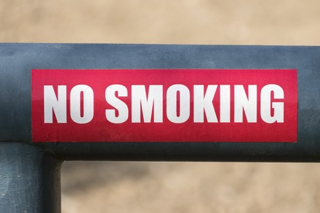No smoking sign on mountain park gate.   Stock Photo