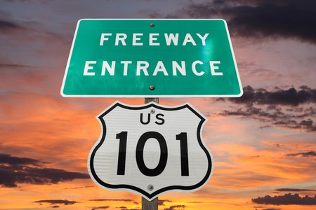US 101 freeway entrance sign with sunset