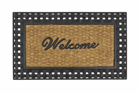 welcome mat: New welcome mat isolated on white. Stock Photo