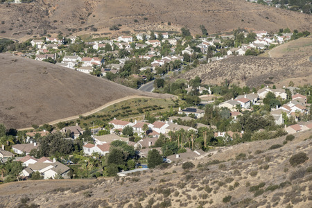 Simi Valley suburban homes nestled into the hillside valleys of Southern California.   Stock Photo