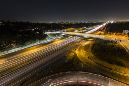 time lapse: Sunset Blvd ramps and the San Diego 405 freeway at night in Los Angeles, California.