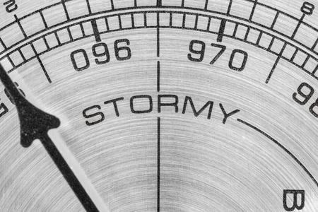 barometer: Stormy barometer gauge macro detail.