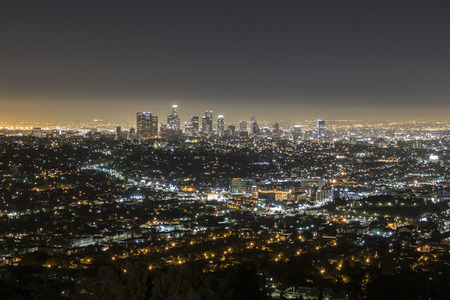 griffith: LOS ANGELES, CALIFORNIA - September 30, 2014:  Predawn glow of downtown Los Angeles from Griffith Park in the Hollywoood Hills. Editorial