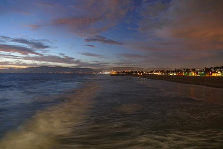 Dusk surf at famous Venice beach in Los Angeles, California. photo
