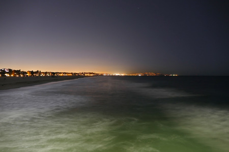 Venice Beach surf at night. photo