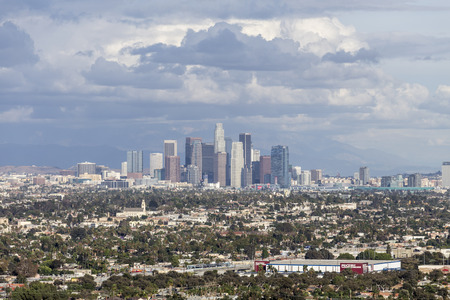 gabriel: Los Angeles, California, USA - November 1, 2014:  Downtown Los Angeles and the San Gabriel Mountains with gathering storm clouds.